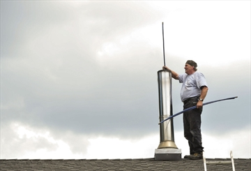 Chimney Sweep cleaning flue